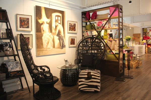 Modern-Eclectic-Living-Peacock-chairs-and-artwork